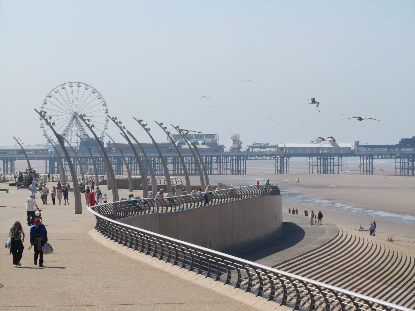 Blackpool seafront, looking towards Central Pier with North Pier behind you