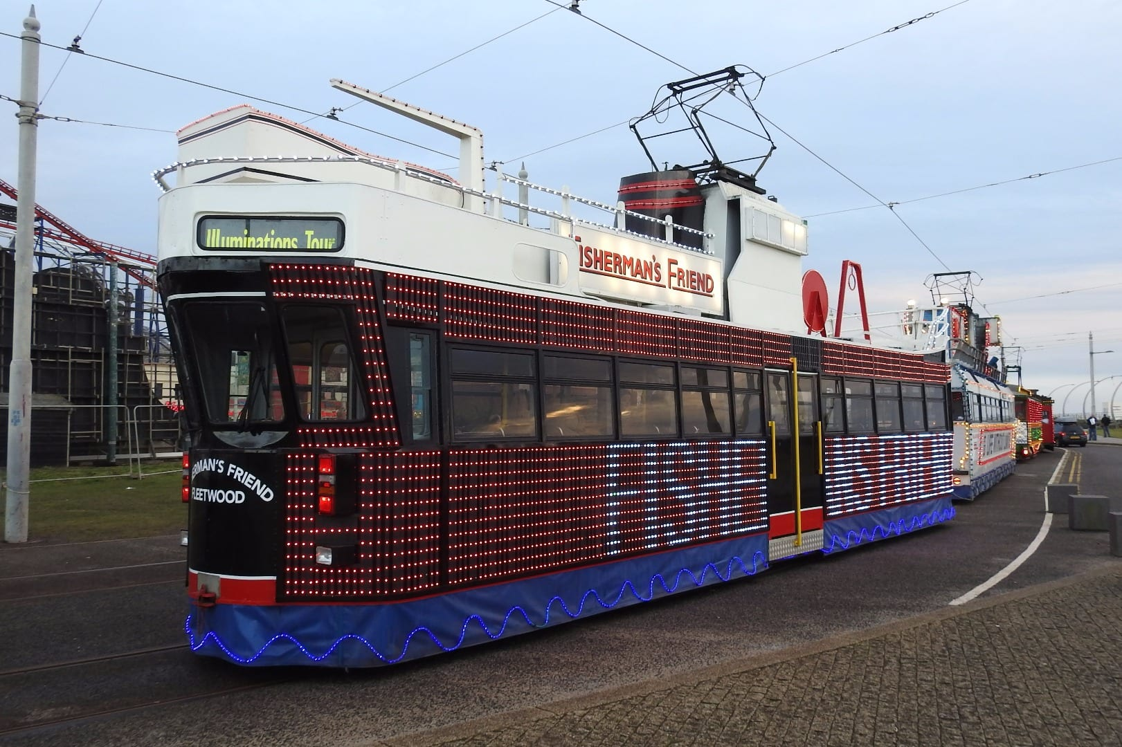 Trams depart to begin the parade