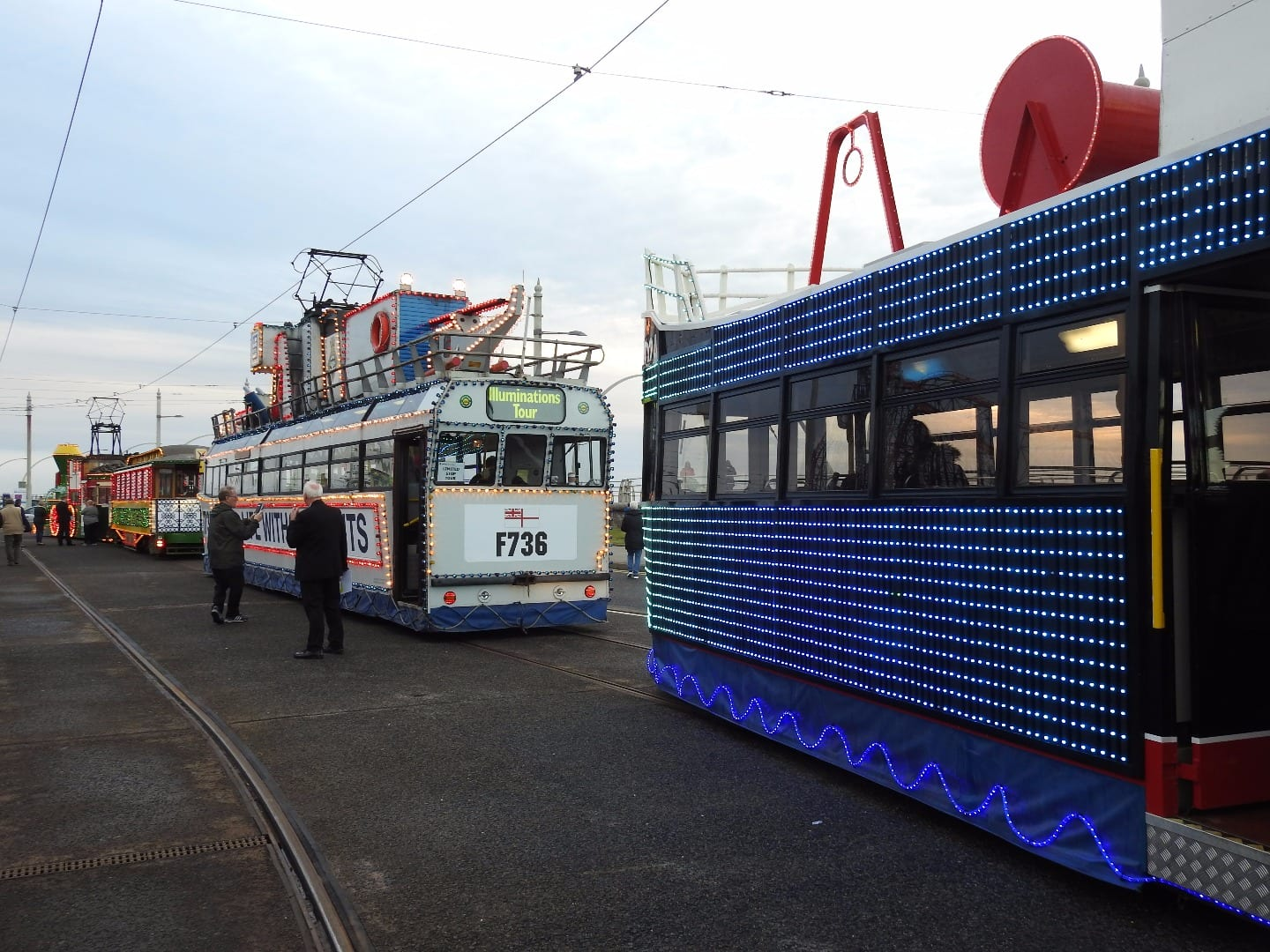 At Pleasure Beach the three trams begin to glow as dusk approaches.