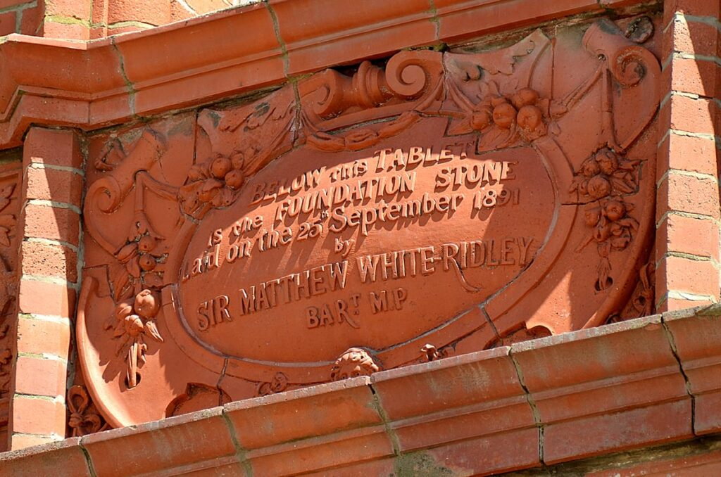 Commemorative Plaque on Blackpool Tower, one of many traces of Blackpool's past