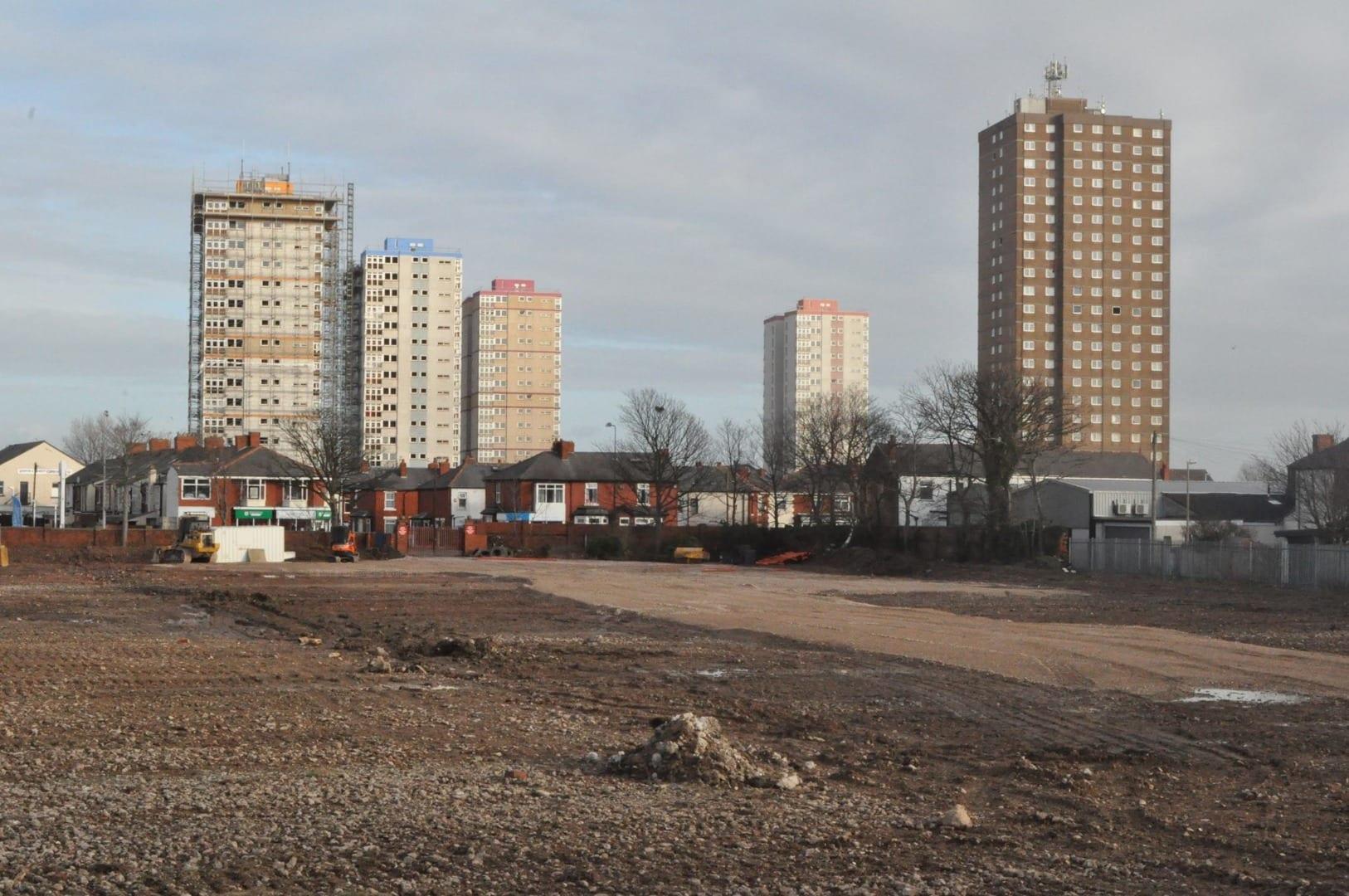 The five blocks of the Queens Park flats before demolition began