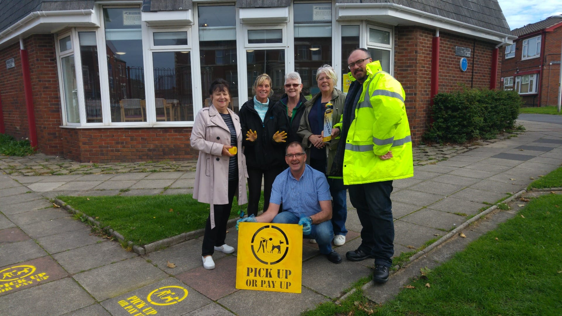 Councillors and residents spray anti-dog fouling messages on the floor in Blackpool