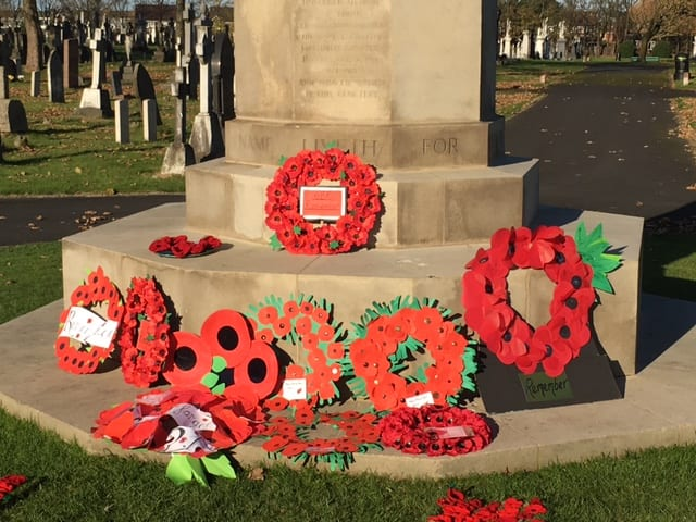 Knitted poppies display for Remembrance Day at Layton Cemetery