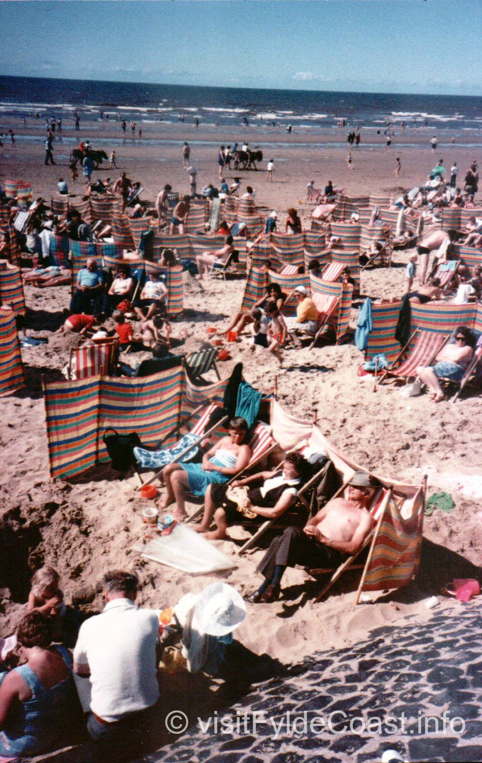 Busy beach -donkey rides and deckchairs. Old Blackpool photos, archives from Visit Fylde Coast
